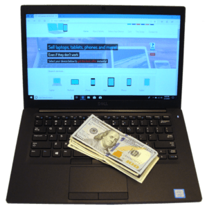 Laptop and Cash